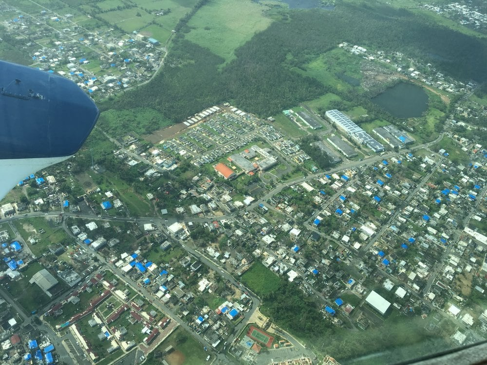 Arial view of houses with blue tarps on the roofs