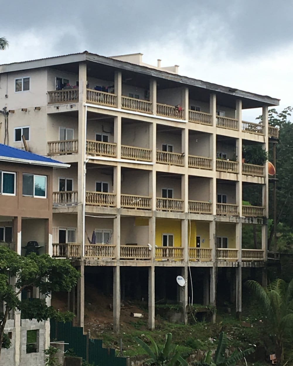 Run-down, four-story condo on hillside